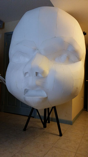 Giant Evil Baby Head created for doll-themed haunted house