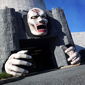 Enormous 8' Zombie Head with matching hands and castle facade built for Chamber of Horrors haunted house